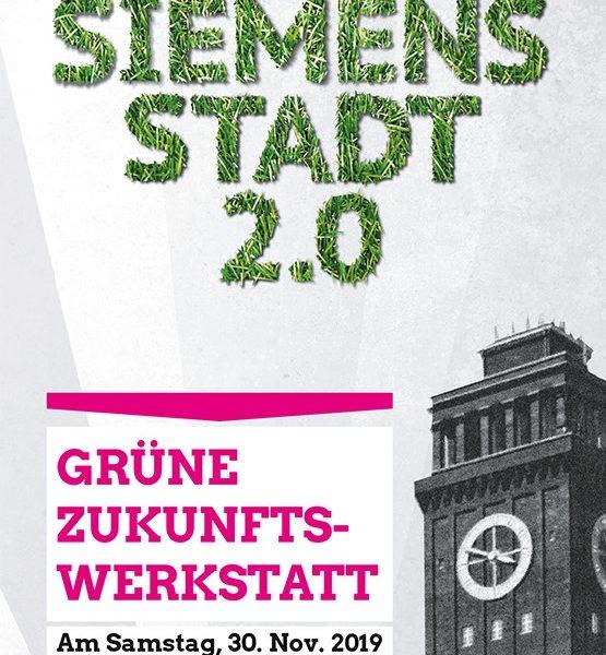 """Backsteinturm in der Siemensstadt, """"Siemensstadt 2.0"""" - Schrift von Gras überwuchert"""